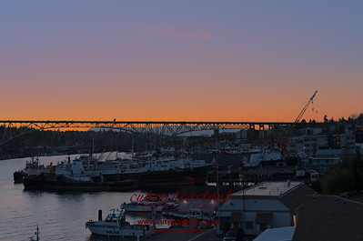 The sunset over Lake Union Fisheries.  Aurora Avenue Bridge and Olympic Mountains...