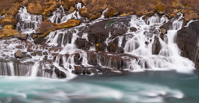 Hraunfossar waterfalls emerge not from a river, but from between layers of lava!  So cool!