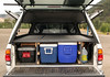 This camper shell comes with a custom interior with 7 separate storage compartments.  It\'s high enough that you can stow coolers underneathe, but still put lots of stuff on top.  You can even sleep on top of it.