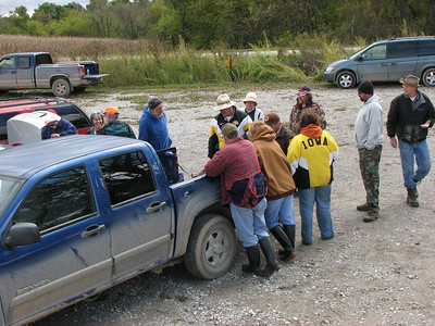 Discussing our finds. There are no picnic tables at Cedar Bluff, so we had to use the back of a pickup truck.