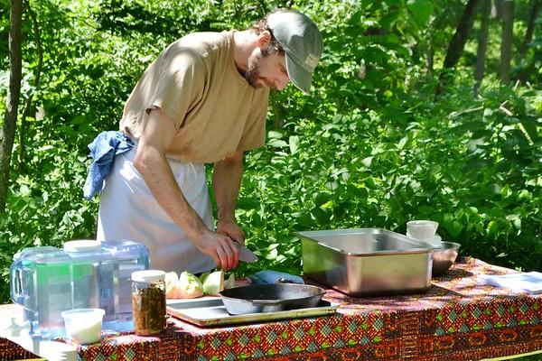 Chef David Wieneneck starts to prepare the food.