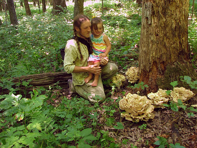 "Ansel shows Oona the big ""Black Stainer"" mushrooms."