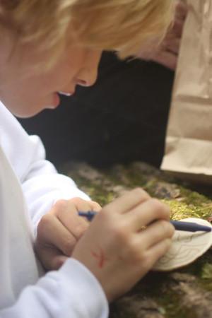 Kaitly creates an artwork on the fungus.