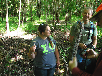 Chelsea and Marty discuss the identifying features of this Xerula species, while Roger gets his camera ready.