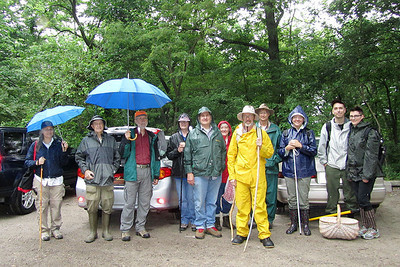 We all pose for a picture in the rain before we head into the woods