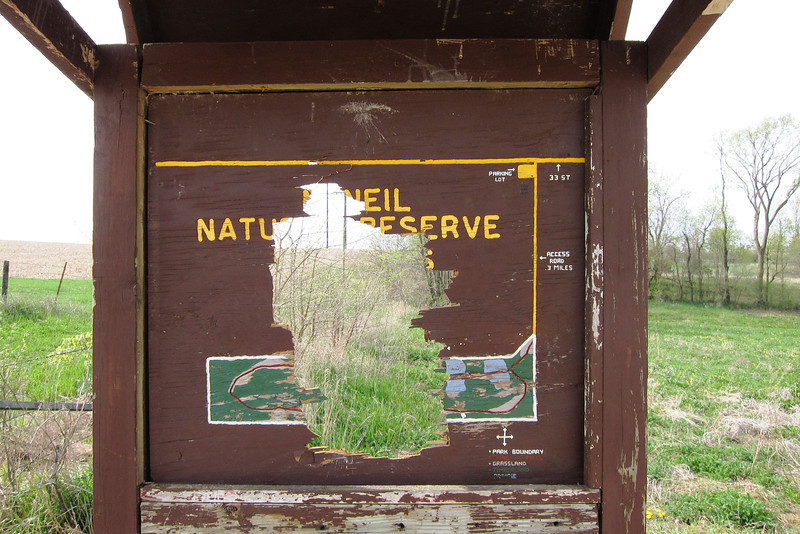 The sign and map minus the part removed by a shot gun blast.