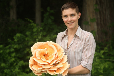 Cody shows off her tasty find, a Laetiporus cincinnatus
