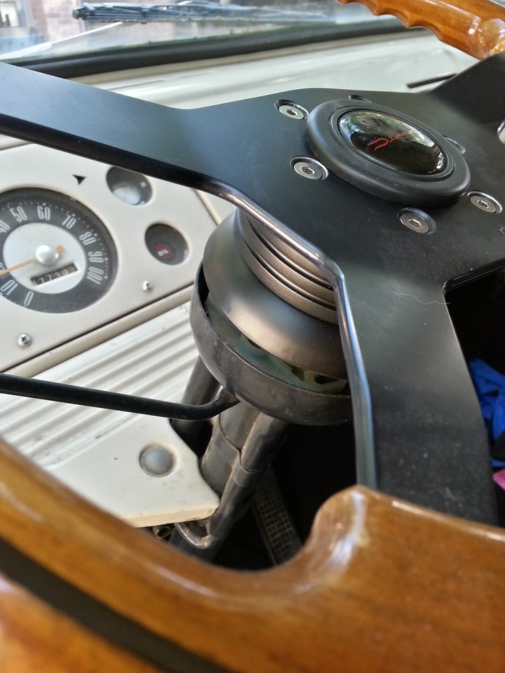 """Trying kits for the 'wheel; this was the best fit, but there is a gap. The wheel is sentimental, came out of a custom Chevy conversion van that I bought from my grandparents while in college. I totaled """"Hotel Chevy"""" in 2002, but kept the wheel."""