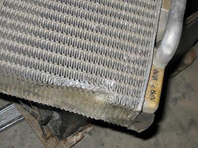 Leaky heater repair: dented fins.