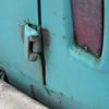 Day 1.  Broken hinge pin on rear barn door, dent.