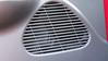 Factory speaker shown through grill