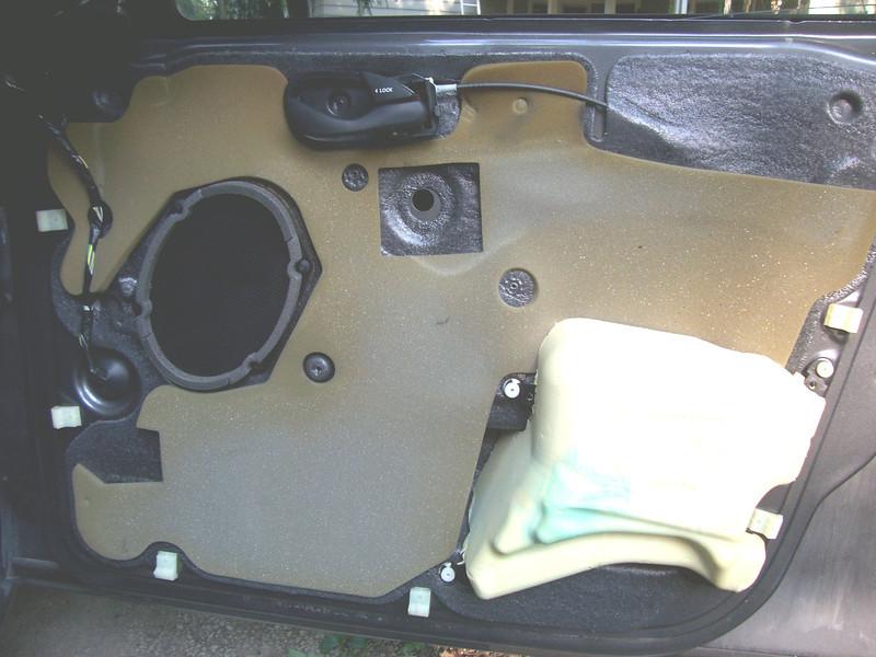 Door panel removed to expose OEM speaker