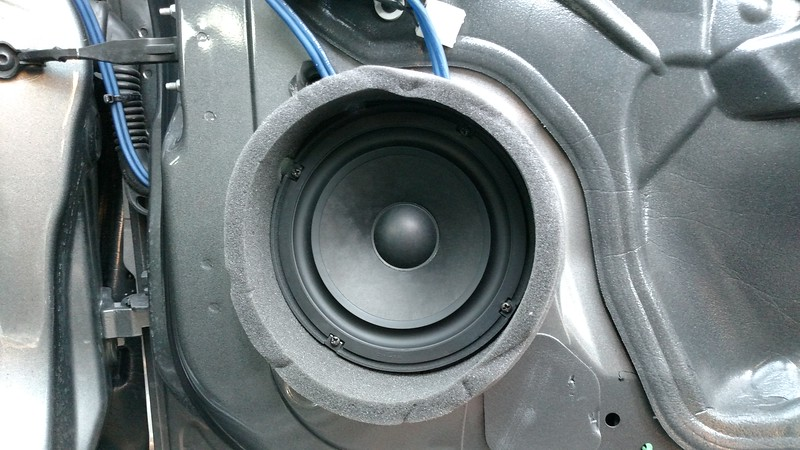 """Aftermarket speaker, and speaker adapter    from <a href=""""http://car-speaker-adapters.com/items.php?id=SAK113""""> Car-Speaker-Adapters.com</a>  installed on door"""