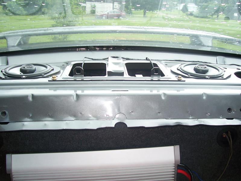 Speaker adapters and aftermarket speakers installed in rear deck.