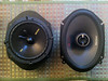"Left: Aftermarket 6 1/2"" speaker mounted to speaker adapter from  <a href=""http://www.car-speaker-adapters.com/items.php?id=SAK006""> Car-Speaker-Adapters.com</a>  <br> Right: Aftermarket 6x8"" speaker"