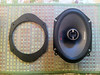 "Left: Speaker adapter from  <a href=""http://www.car-speaker-adapters.com/items.php?id=SAK006""> Car-Speaker-Adapters.com</a>  <br> Right: 6x8"" Aftermarket speaker"