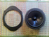 "Left: Speaker adapter from  <a href=""http://www.car-speaker-adapters.com/items.php?id=SAK006""> Car-Speaker-Adapters.com</a>  <br> Right: Aftermarket 6 1/2"" speaker"