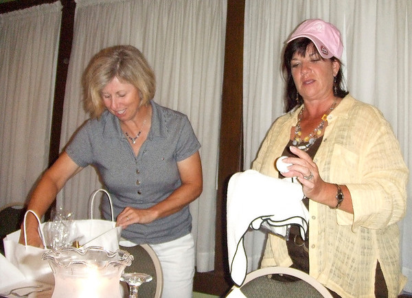 Ellen Port of St. Louis presented a goodie bag from the team to Stephany Powell.....