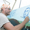 Petersen Thomas painting the Pine Mountain Benefit Mural.
