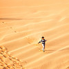 Boy Running the Dunes, outside Abu Dhabi.