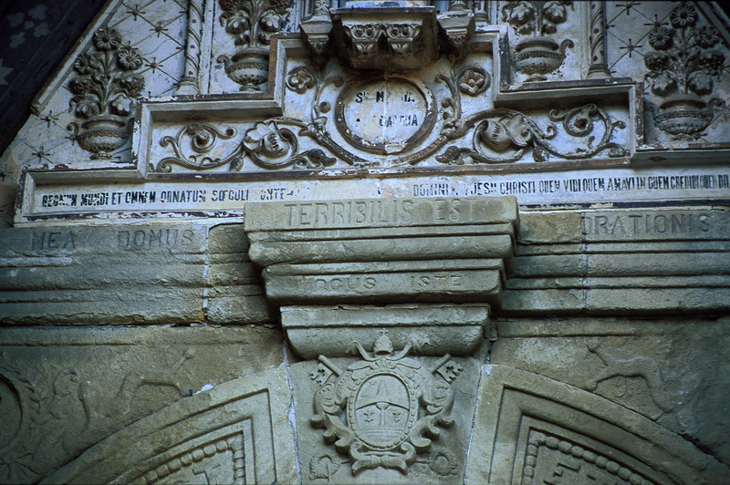 Rennes-le-Chateau - Terribilis Est.  This is above the door of the church entrance.