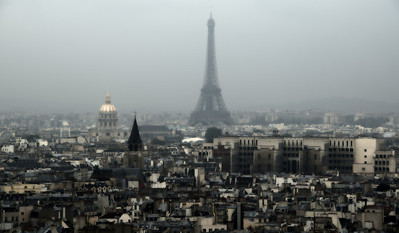 Looking at the Eiffel tower on a misty day.