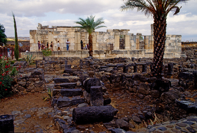 The white Synagogue of Capharnaum, Black lava stone foundations of old structures.