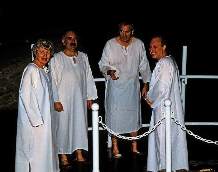 Preparing for baptism in the Jordan.  For a few dollars you can rent a white robe.