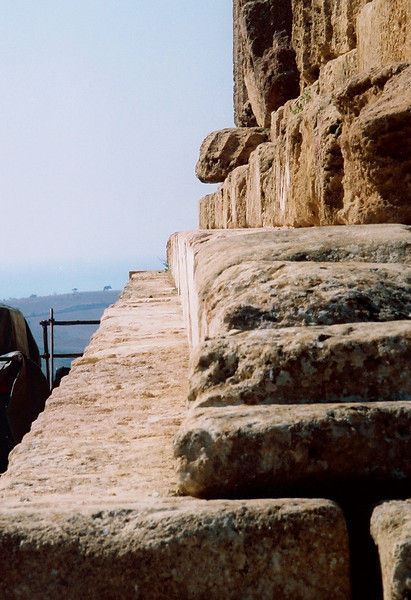 Agrigento Valley of the Temples.  This is a photo of the top step to support the theory that the Greeks did not believe in straight lines.  Rather a straight line curved at both ends is more pleasing to eye.