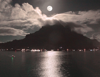 Full moon rises over the volcano at Bora Bora South Pacific French Polynesia