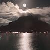 Full moon rises over the volcano at Bora Bora South Pacific French Polynesia