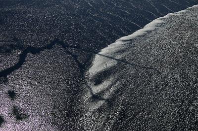 Tree Shadow on Black Sand beach. tahiti French Polynesia