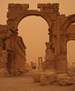 Palmyra - Monumental Arch at the start of the Great Colonnade.  The sand storm is picking up, creating unusual light.