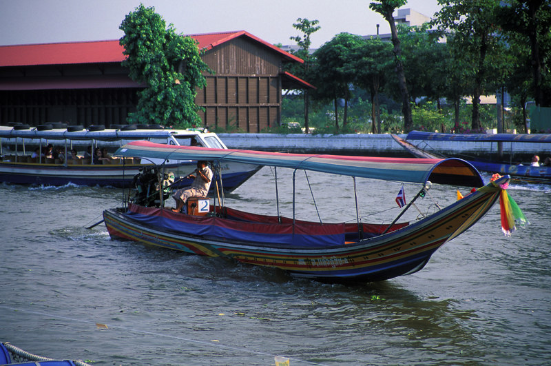 Bangkok<br /> The local river transportation.  The diesel engine is from an Isuzu lorry.