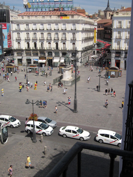 View from my balcony on to Puerta del Sol, one of Madrid's biggest and busiest plazas