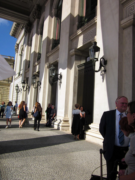 """Arriving at the opera house early before the performance of """"La Traviata""""; easy to get a ticket now--people stood outside selling extras at a discount"""