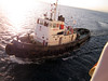 Pilot's tug pulls away once we've left the harbor