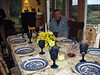 "Bob arranging the table for Friday night dinner at their home in Nova Scotia's ""South Shore"" region--""La Have Islands"" area"