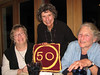 "Nina and Sue present me with a handsome ""hooked"" Oberlin 50th anniversary cushion; Nina's the hooking artist"