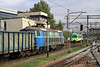 Old And New Meet At Gliwice.<br /> ET22-1161 Waits For A Green Light,as Brand New Unit 120-313 Sneeks Around The Back in a Brief Break in The Clouds on Tuesday,1st Oct 2013.