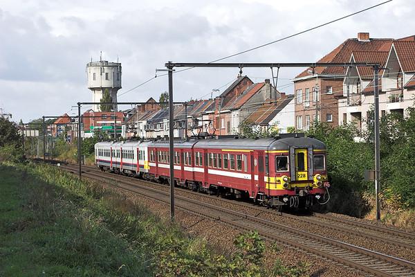 228 and 610, Wetteren 7/10/2011 R560 1037 Brugge-Mechelen
