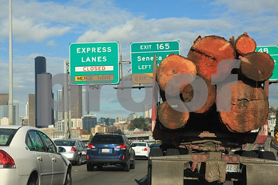 Log truck on Interstate #5 passing through Seattle, WA