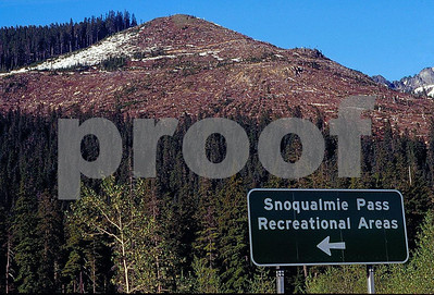 A sign along Interstate 90 as it passes over Snoqualmie Pass, WA