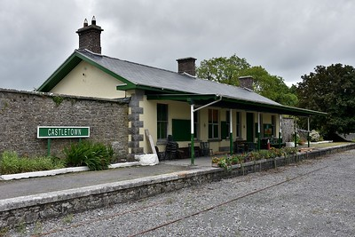 "The closed Ballyglunin Station between Tuam and Athenry. The station is famous for being the location of Castletown Station in the 1952 film ""The Quiet Man"" starring John Wayne and Maureen O'Hara. Note the Castletown nameboard. Mon 06.08.18"