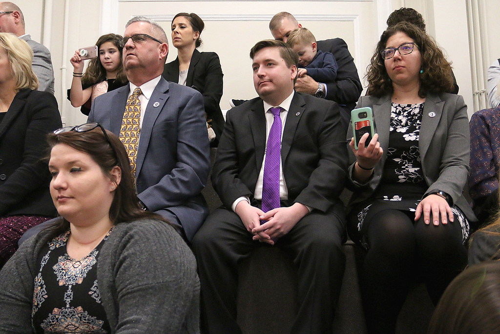 . State Rep. Stephan Hay, State Rep Jon Zlotnik and State Rep. Natalie Higgins listen to former senator Jennifer Flanagan\'s farewell speech on the senate floor on Wednesday morning at the state house. SENTINEL & ENTERPRISE/JOHN LOVE