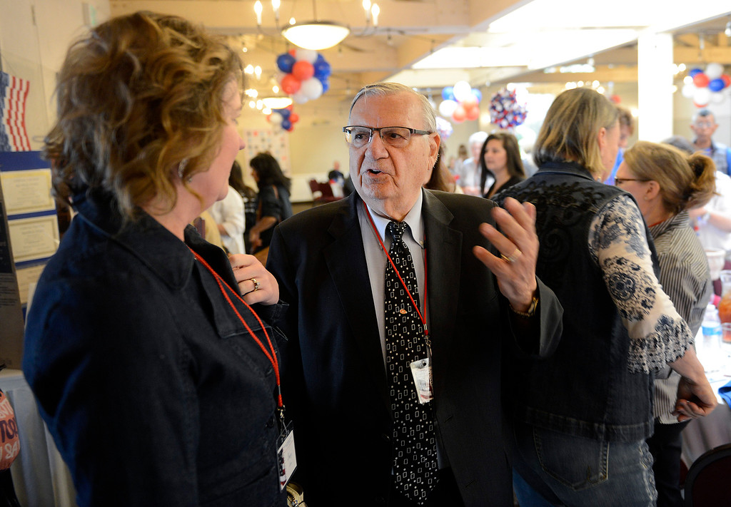 . Stacy Oliver talks with Joe Arpaio, the former sheriff of Maricopa County in Arizona, who spoke at the Monterey Peninsula Republican Women Federated luncheon in Carmel Valley on Thursday, September 13, 2018.  (Vern Fisher - Monterey Herald)