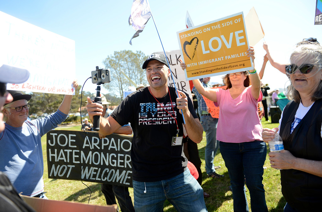 . President Trump proponent Ben Bergquam tries to engage people protesting Joe Arpaio, the former sheriff of Maricopa County in Arizona, who spoke at the Monterey Peninsula Republican Women Federated luncheon in Carmel Valley on Thursday, September 13, 2018.  (Vern Fisher - Monterey Herald)
