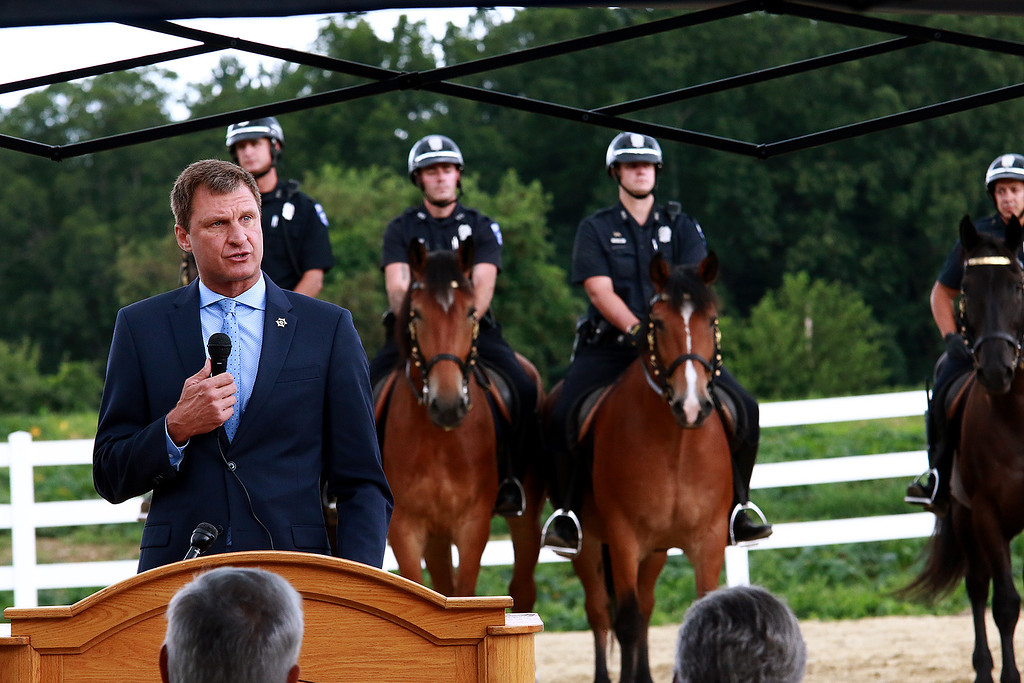 ". Worcester County Sheriff Lew Evangelidis celebrated the official ribbon cutting and dedication of the Worcester Mounted Police Unit Horse Barn and Stables. The recently retro-fitted barn will be named after former Sheriff John ""Mike\"" Flynn who was a former member of the Fitchburg Police Department. This is just some of the scenes from today\'s ceremony. SENTINEL & ENTERPRISE/JOHN LOVE"