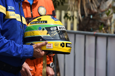 A marshal holding aan Ayrton Senna replica helmet, Monaco 2019