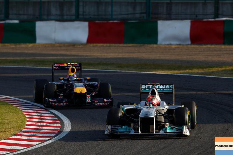 Motorsports: FIA Formula One World Championship 2011, Grand Prix of Japan, 07 Michael Schumacher (GER, Mercedes GP Petronas F1 Team),   02 Mark Webber (AUS, Red Bull Racing),